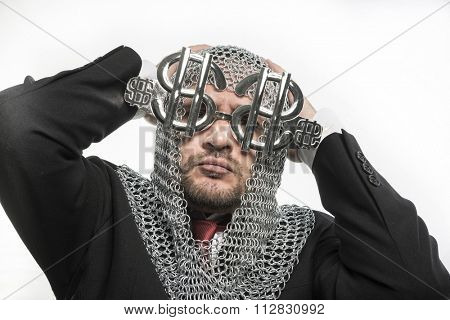 safety, businessman with medieval executioner in metal and silver glasses. concept of protection of savings and money