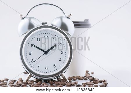 Coffee and alarm clock waiting together.
