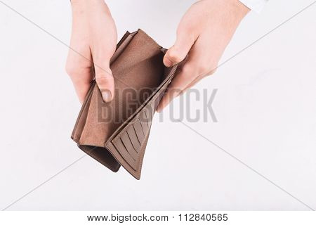 Male hands demonstrating an empty wallet.