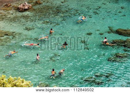 Tourists Enjoy The Clear Water Of The Beautiful Beach In Tsigrado Beach In Milos Island, Cyclades, G