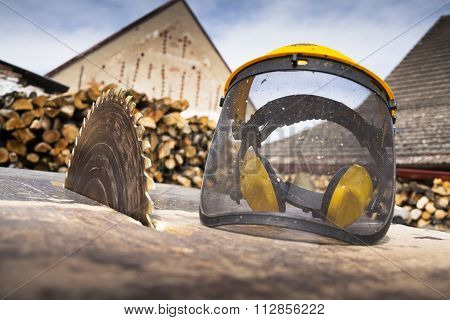 Protective Helmet On Switched Off Old Rusty Circular Saw
