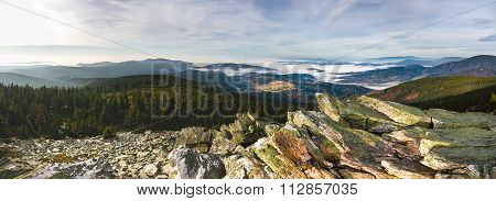 Panoramic View From Rocky Mountains Into Valleys With Low Clouds