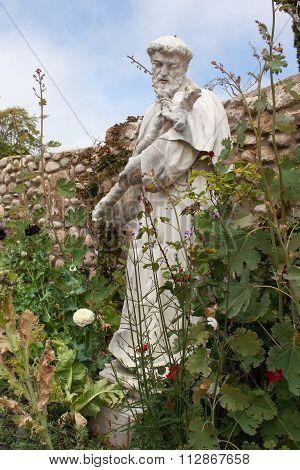 Statue In Wild Garden Of Carmel Mission, Usa