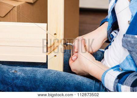 Assembling Wood Furniture Using Hex Key. Diy.