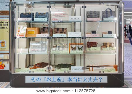 TOKYO JAPAN - NOVEMBER 29 2015: Couterfeit and illegal items displayed at the terminal two of Narita international airport
