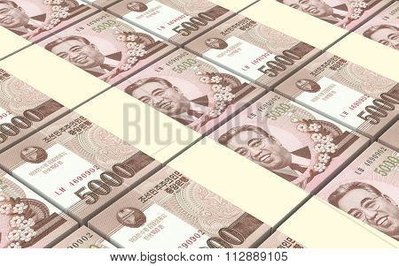 North Korea won bills stacks background. Computer generated 3D photo rendering.