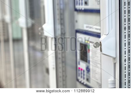 Front glass doors on electrical control cubicles in control room on electrical substa