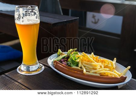 Grilled Sausages With French Fries And Weiss Beer