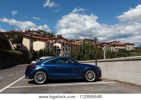 Audi TT in front of the village Verni in tuscany