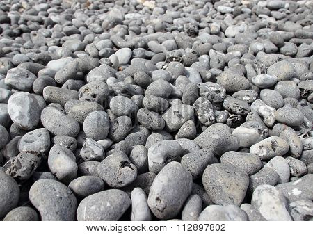 Rubble Beach Stones With Endless Perspective Background