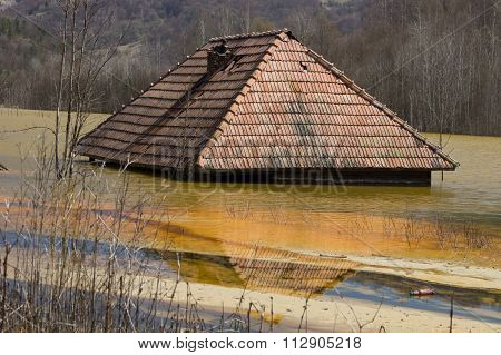 House Sinking in Polluted Lake