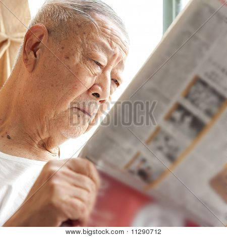 A Senior Man Is Reading