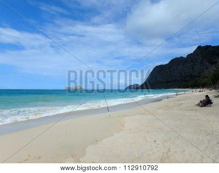 People Fish And Play On Waimanalo Beach