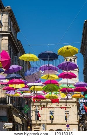 Arles, France - September 21, 2015: Street decorated with colored umbrellas at Arles Provence. France. 2015