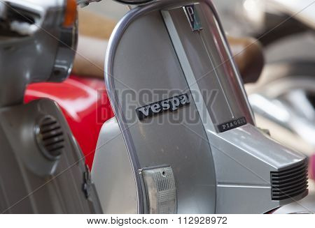 Close up of Vespa logo on an old Piaggio motorcycle