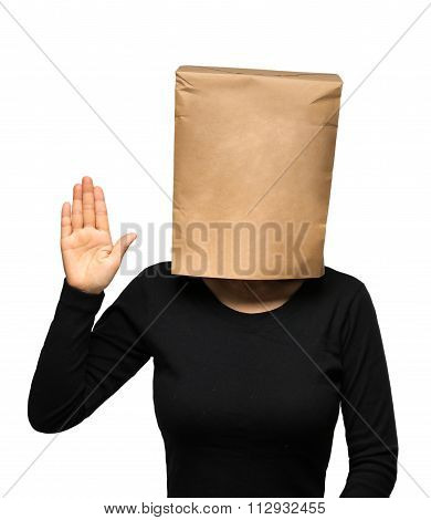 young woman covering his head using a paper bag.