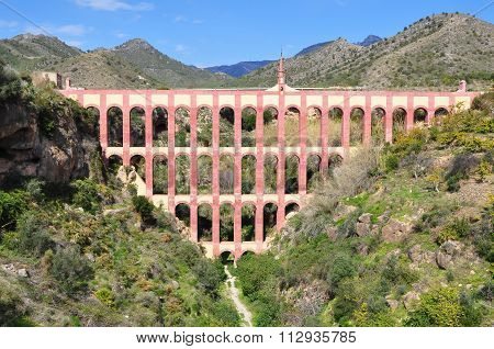 Historical Landmark Old Aqueduct Puente del Aguila or Eagle Bridge in Nerja, Malaga, Spain.