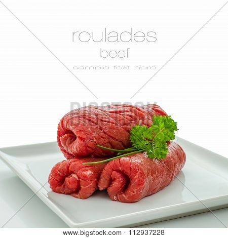 Three Raw Roulades Beef On White Plate,