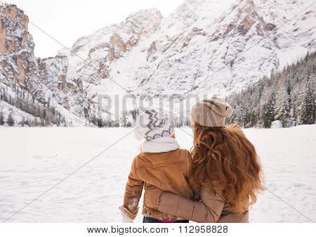 Seen From Behind Mother & Child Looking On Snow-capped Mountains