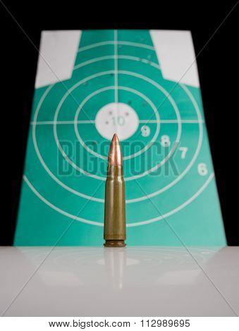 Gun Cartridge Over Target With Bulletholes