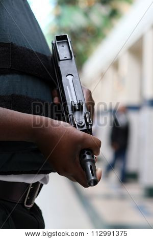 Armed Guard Protecting Money With Machine Gun