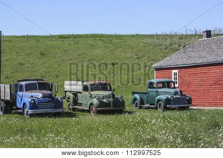 CALGARY, AB, CANADA Three well-used pick-up trucks rest outside a barn on the Bar U  Ranch Historic Site in southern Alberta, Canada on June 8, 2015. After 70 years as one of the most successful ranches, the Bar U now gives tourists a taste of the cowboy