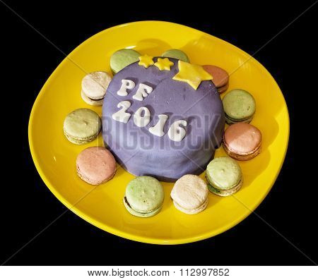 The Title Pf 2016 Written On Festive Cake With Handmade Macaroons