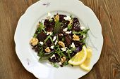 Black rice, arugula, sun-dried plums, walnuts and feta, salad, view from above poster