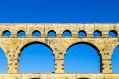 Pont du Gard is an old Roman aqueduct near Nimes in Southern France poster