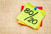 Pareto principle or eighty-twenty rule represented on a sticky note - a reminder or advice poster