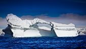 Antarctic iceberg in the snow. Beautiful winter background poster