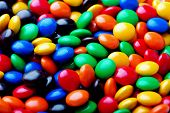 close up shot of colorful candy . poster