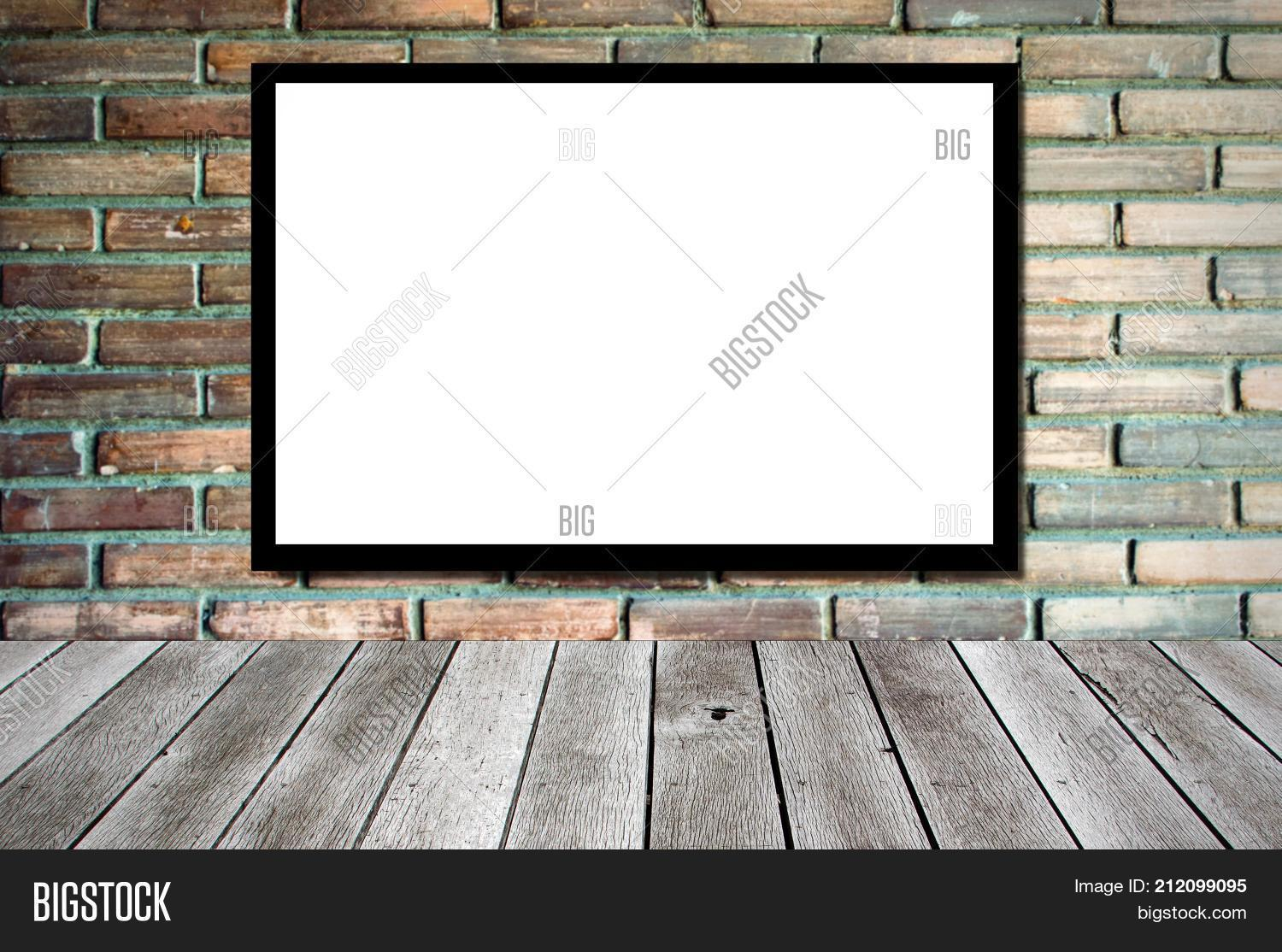 Blank Advertising Billboard Or Wide Screen Television On Old Vintage Brick Wall Background And Wooden Shelf