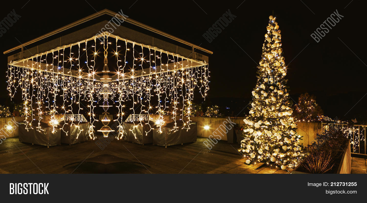 Engraved Christmas Tree And Pergola On The Terrace Of House Ornate Lighted