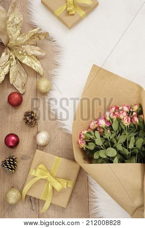 Large Luxury Bouquet Of Roses, Christmas Balls And Gifts On A Fur Carpet. Winter Holidays Concept