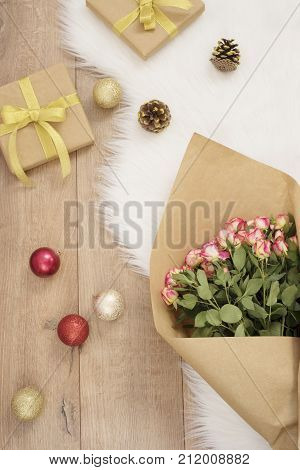 Large Luxury Bouquet Of Roses, Christmas Balls And Gifts On A Fur Carpet