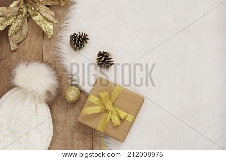 Merry Christmas. Winter Holidays Concept - Cozy Home, Hat, Gift, Cones