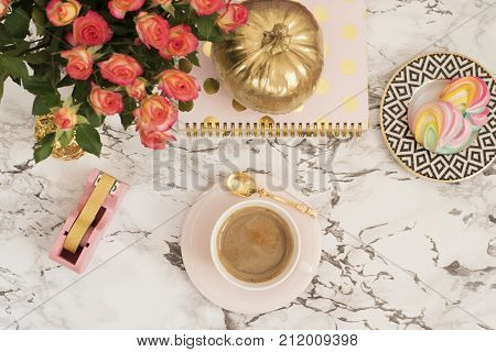 Feminine Workplace Concept. Freelance Workspace In Flat Lay Style With Coffee, Flowers, Golden Pumpk
