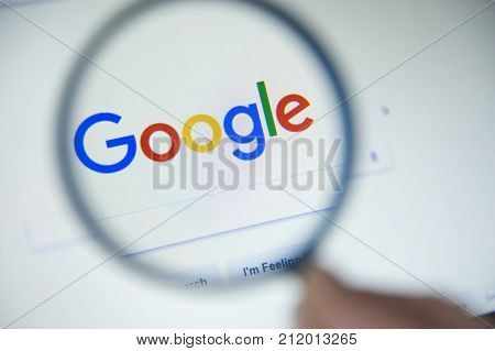 Paris, France - October 19, 2017 : Google.fr Homepage On The Screen Under A Magnifying Glass. Google