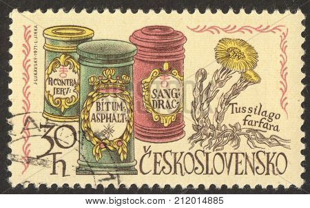 MOSCOW RUSSIA - CIRCA OCTOBER 2017: a stamp printed in CZECHOSLOVAKIA shows Apothecary Jars and Coltsfoot the series