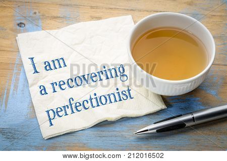 I am a recovering perfectionist  - handwriting on a napkin with a cup of tea