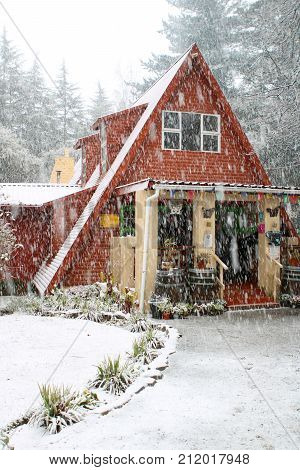 Winter scene of a quaint cottage in the forest during the snow