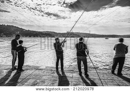 ISTANBUL, TURKEY: Fishers in Kurucesme, Arnavutkoy area of Istanbul. By the Bosphorus channel on October 7, 2017