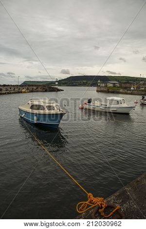 carnlogh harbour with boats moored at dock