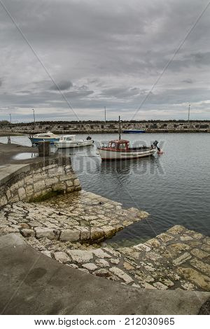 small boats in carnlogh harbour north ireland