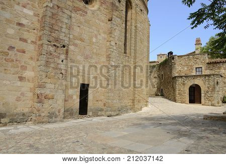 Stone buildings at the streets of the medieval village of Pals located in the middle of the Emporda region of Girona Catalonia Spain. poster