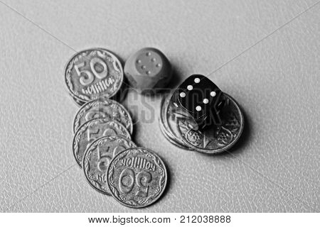 Game blocks and coins on a gray table