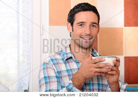 Man with bowl of cereal