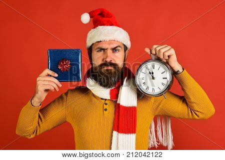 Christmas Eve And Gifts Concept. Santa Claus Holds Blue Present
