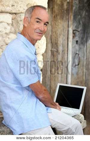 Man using his laptop outside
